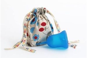 blue sckoon menstrual cup with pattern bag
