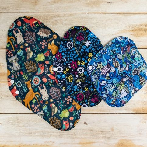 cloth pads with designs on wood